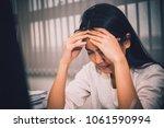 asian woman working in office... | Shutterstock . vector #1061590994