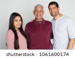 three members of a happy...   Shutterstock . vector #1061600174