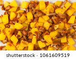 fried potatoes with mushrooms... | Shutterstock . vector #1061609519