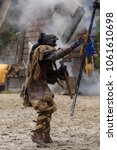 Small photo of PROVINS, FRANCE - MARCH 31, 2018: Unidentified scary villain during the attack on the kingdom in the medieval reconstruction of Legend of the Knights