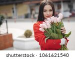 woman with tulips. beautiful... | Shutterstock . vector #1061621540