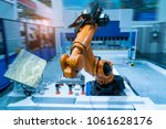 Small photo of robotic pneumatic piston sucker unit on industrial machine,automation compressed air factory production