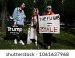 activists protest against... | Shutterstock . vector #1061637968