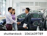 young asian salesman greeting... | Shutterstock . vector #1061639789