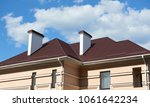 roof of a private house with a...   Shutterstock . vector #1061642234