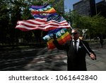 activist holds us and rainbow... | Shutterstock . vector #1061642840