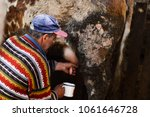 old man milking the cow  | Shutterstock . vector #1061646728