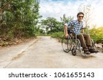 young man sitting on wheelchair ... | Shutterstock . vector #1061655143