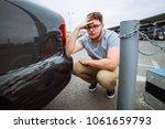 sad man sit near dint car with... | Shutterstock . vector #1061659793