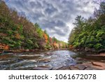 Small photo of Vivid Autumn colors abound along the rapids of a wild river in the Appalachian mountains of Maryland