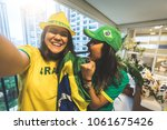 brazilian fan celebrating... | Shutterstock . vector #1061675426