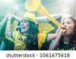 brazilian fan celebrating... | Shutterstock . vector #1061675618