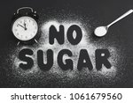 spoonful of sugar and an alarm... | Shutterstock . vector #1061679560