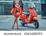 sexy stylish girl wearing a red ...   Shutterstock . vector #1061688293