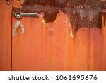 rusty truck door with handle | Shutterstock . vector #1061695676