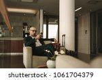 business traveler waiting in... | Shutterstock . vector #1061704379