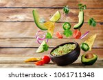 guacamole with flying corn... | Shutterstock . vector #1061711348