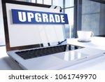 upgrade text on modern laptop...   Shutterstock . vector #1061749970