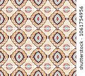 ikat geometric folklore... | Shutterstock .eps vector #1061754956