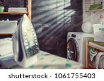 iron and cloth on ironing board ... | Shutterstock . vector #1061755403
