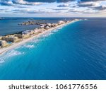 cancun with blue water | Shutterstock . vector #1061776556
