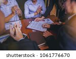 businessman signing a contract... | Shutterstock . vector #1061776670