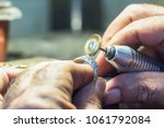 male jeweler polishing a silver ... | Shutterstock . vector #1061792084