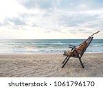 acoustic guitar near the deck... | Shutterstock . vector #1061796170