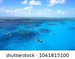 Small photo of PORT DOUGLAS, AUSTRALIA -1 AUG 2017- Tourists snorkeling in the Coral Sea on the Great Barrier Reef near the Agincourt Reef in Far North Queensland, Australia.