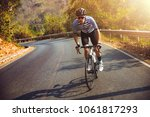 asian men are cycling road bike ... | Shutterstock . vector #1061817293