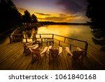 Adirondack Chairs Sitting On A...