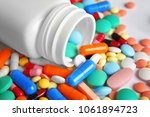bottle and many colorful pills  ... | Shutterstock . vector #1061894723