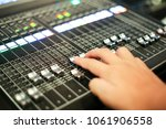 hands push a professional audio ... | Shutterstock . vector #1061906558