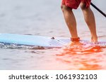 speed competition on stand up... | Shutterstock . vector #1061932103