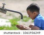 african american boy drinking... | Shutterstock . vector #1061936249