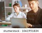 blurry businessman using laptop ... | Shutterstock . vector #1061951834