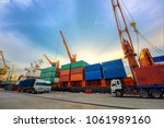 the sea and land transport meet ... | Shutterstock . vector #1061989160