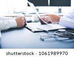 doctor explaining for patient... | Shutterstock . vector #1061989970