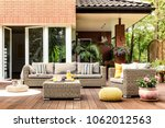 yellow pouf next to a rattan... | Shutterstock . vector #1062012563