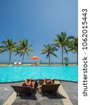 two women at the swimming pool... | Shutterstock . vector #1062015443