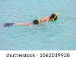 beach vacation couple wearing a ... | Shutterstock . vector #1062019928