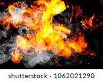 dense fiery flames smoke on a... | Shutterstock . vector #1062021290