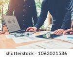 startup business team meeting... | Shutterstock . vector #1062021536