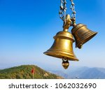 temple bells in closeup | Shutterstock . vector #1062032690