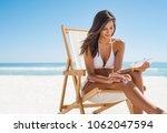 young woman in white bikini... | Shutterstock . vector #1062047594