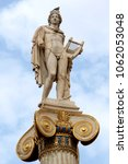 Small photo of Ionic column with a statue of Apollo at Athens University.