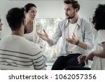 group therapist. nice pleasant... | Shutterstock . vector #1062057356