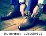 modern man is getting dressed | Shutterstock . vector #1062059528