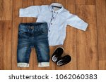 child's classic clothes on... | Shutterstock . vector #1062060383