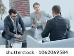 woman lawyer advises his client | Shutterstock . vector #1062069584